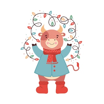 Cute cartoon baby bull with a sparkling christmas garland. funny ox in clothes, scarf, boots, winter jacket. symbol 2021 new year. holiday card or banner for christmas, new year. illustration