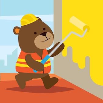 壁を塗っている建設労働者としてのかわいい漫画のクマ