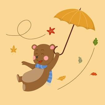 우산을 들고 귀여운 만화 곰 비행 프리미엄 벡터
