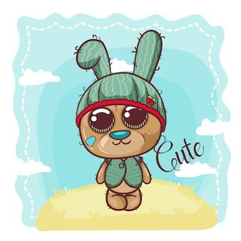 Cute cartoon bear in a hat - vector