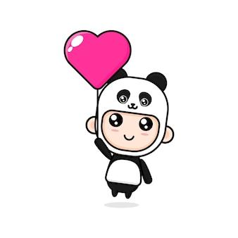 팬더 의상을 입고 귀여운 만화 소년