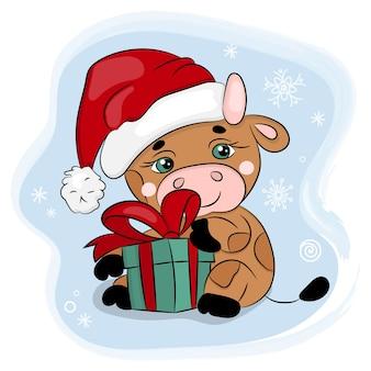 プレゼント付きのサンタハットのかわいい漫画の雄牛。メリークリスマス手描きイラスト