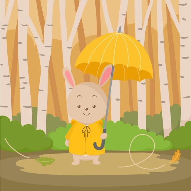 우산을 들고 귀여운 만화 토끼