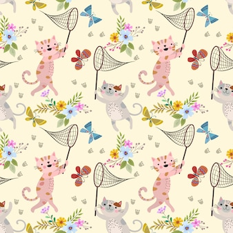 Cute cartoon cat and butterfly in flowers garden pattern.