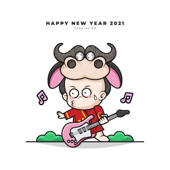 Cute cartoon character of chinese baby with ox costume was playing guitar and happy new year greetings