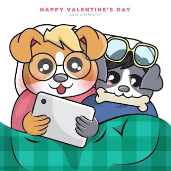 커플 강아지의 귀여운 만화 캐릭터는 태블릿과 해피 발렌타인을보고 있었다