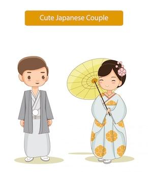 伝統的なドレスで日本人カップルのかわいい漫画。 Premiumベクター