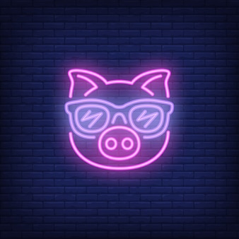 Cute cartoon pink pig in sunglasses. neon sign element. night bright advertisement.