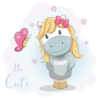 Cute cartoon pony in blue jumper