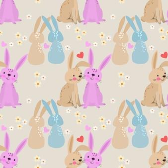 心のシームレスなパターンを持つかわいい漫画ウサギ。