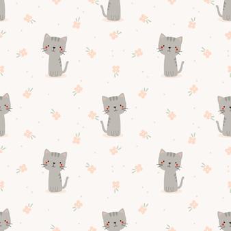 かわいい猫と花のシームレスなパターン。
