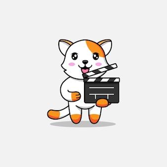 Cute cat carrying a clapperboard