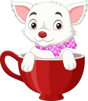 Милый кот мультфильм сидит в красной чашке