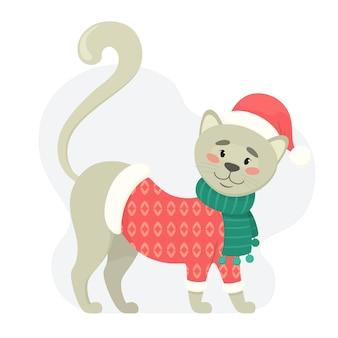 サンタに扮したかわいい猫。冬の服を着た幸せな子猫。