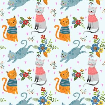 Cute cat in flowers garden seamless pattern.