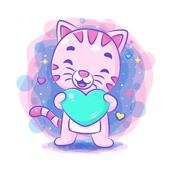 青いハートを保持しているかわいい猫