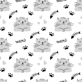 Cute cat seamless pattern with heart footprint fish bone isolated on white background Premium Vector