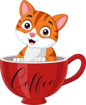 Милый кот сидит в красной чашке