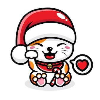 サンタの帽子をかぶったかわいい猫