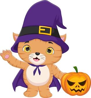 魔女の衣装を着て手を振っているかわいい猫