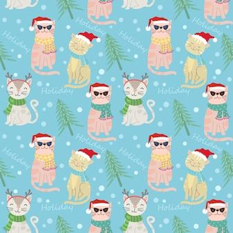 サンタクロース帽子シームレスなパターンとかわいい猫。
