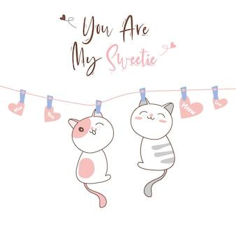 Симпатичные кошки, висящие на веревке на день святого валентина ..