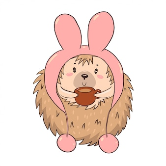 Cute character hedgehog in a hat with rabbit ears drinks tea isolate on a white background.
