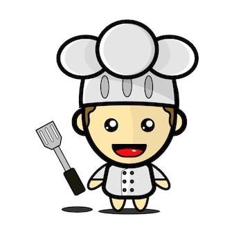 주걱으로 귀여운 요리사 그림 premium vector