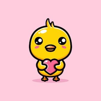 사랑의 마음을 안고있는 귀여운 병아리
