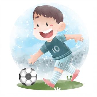 Милый ребенок играет в футбол
