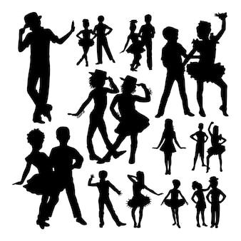 Cute children dancing silhouettes.