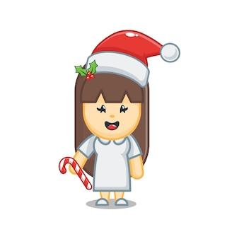 Милая рождественская медсестра держит конфету