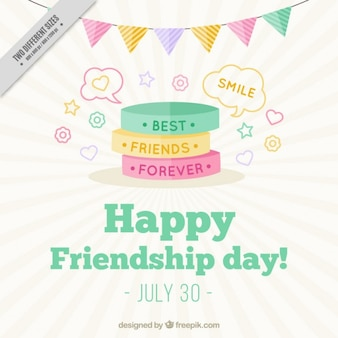Cute colored bracelets background of friendship day