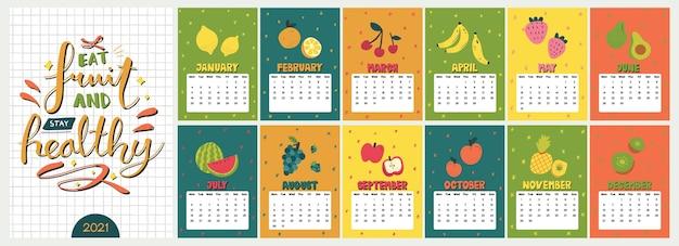 かわいいカラフルなカレンダー。すべての月の面白いスカンジナビアスタイルのフルーツのイラストを使用した年間食事プランナー