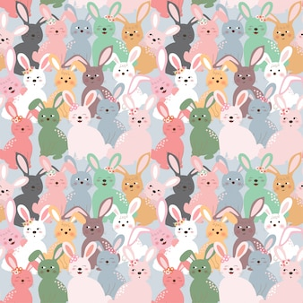 Cute colorful rabbits seamless pattern on pastel blue background