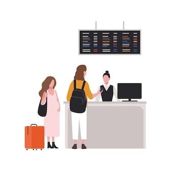 Милая пара на стойке регистрации или паспортном контроле. пара туристов с багажом в аэропорту