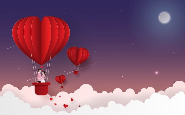 Cute couple on balloon floating on the sky