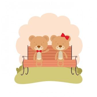 Cute couple of bears sitting on park chair