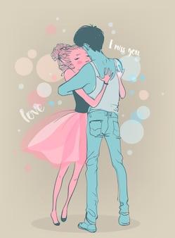 かわいいカップルが抱きしめる