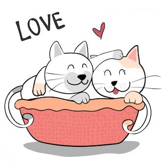 かわいいカップルの友情猫はピンクの背景にお互いを抱きしめます