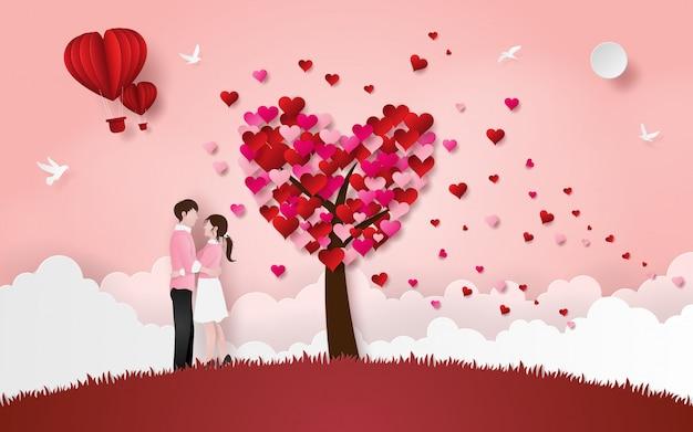 Cute couple hug each other on grass floor with heart tree
