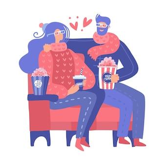 映画館のかわいいカップルが映画を見ています。赤い肘掛け椅子に座って恋に男と女