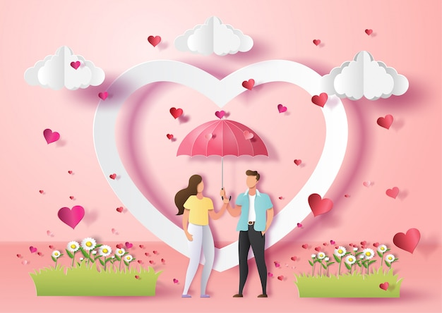 Cute couple in love holding umbrella with many hearts .