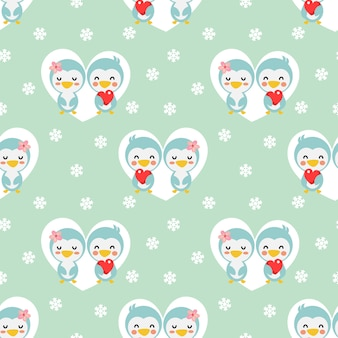Cute couple penguin in heart and snow seamless pattern.