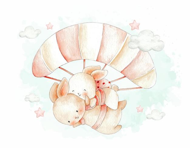 空を飛んでいるかわいいカップルのウサギ水彩イラスト
