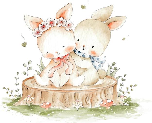 木の水彩イラストに座っているかわいいカップルのウサギ