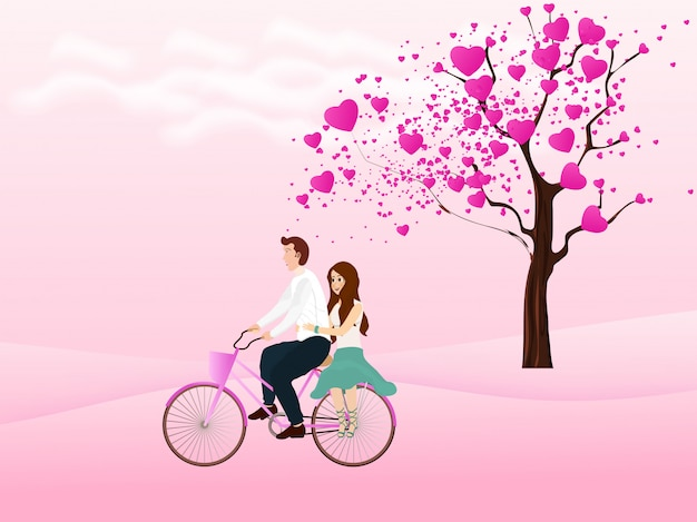 Cute couple riding bicycle and love tree on the background.