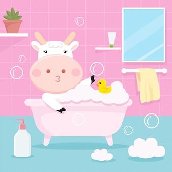Cute cow bathing in the tub