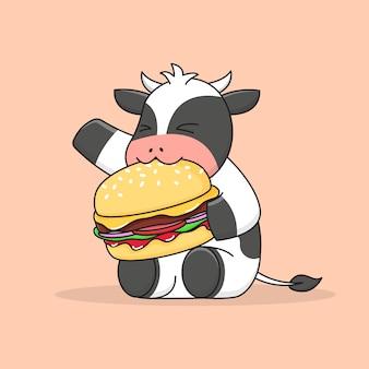 ハンバーガーを食べるかわいい牛