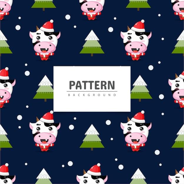 クリスマスのテーマのシームレスなパターンでかわいい牛